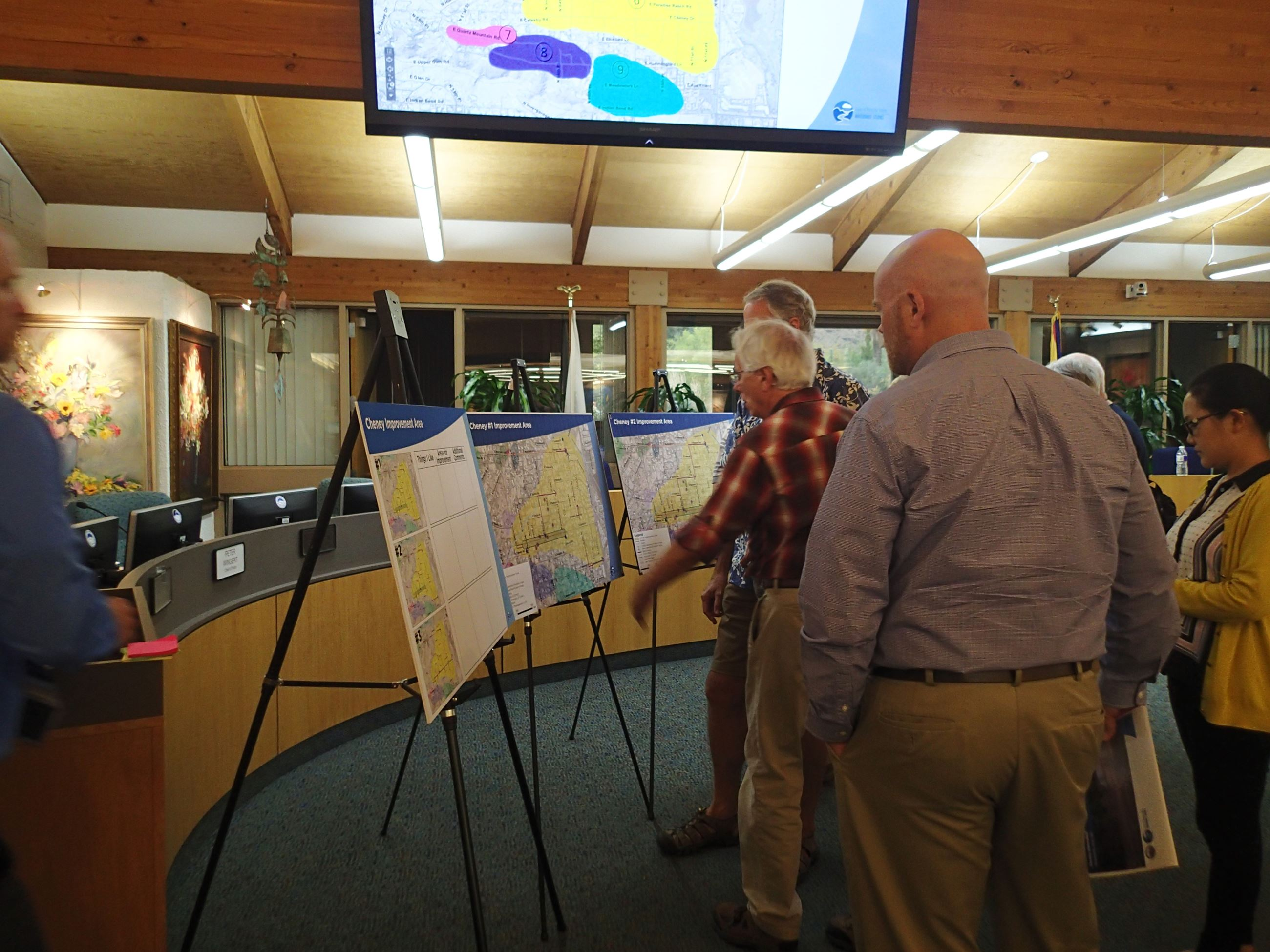 Wathershed Public Meeting Attendees Looking at Displays